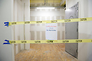 hall taped off with note saying Construction Area Do Not Enter