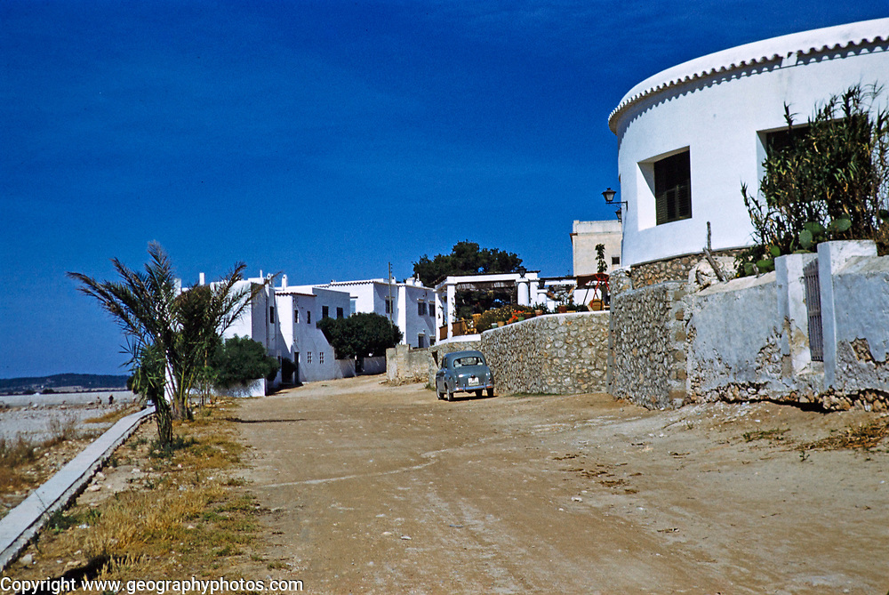 Small Austin A30 car parked outside holiday villas, island of Ibiza, Balearic Islands, Spain, 1950s