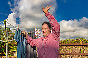Service user hanging out washing.<br /> Client  - Allerton, an integrated social care, housing, and development company.