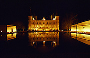 Chateau Château Pichon Longueville Baron floodlit at night with an inverted reflection of the building in the pond in front Pauillac Gironde France Médoc Medoc Bordeaux Gironde Aquitaine France Europe
