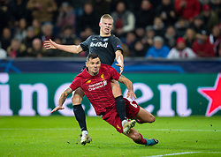 SALZBURG, AUSTRIA - Tuesday, December 10, 2019: Liverpool's Dejan Lovren challenges FC Salzburg's Erling Braut Håland during the final UEFA Champions League Group E match between FC Salzburg and Liverpool FC at the Red Bull Arena. (Pic by David Rawcliffe/Propaganda)