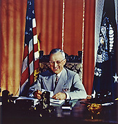 American President Harry S Truman (1884 - 1972) signing the Foreign Aid Assistance Act, which provided a programme of foreign aid to Greece and Turkey. The provision of economic support to any nation resisting communist pressure came to be known as the Truman Doctrine