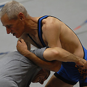 Gay and lesbian wrestlers participate in a wrestling clinic taught by Northwestern University's head men's wrestling coach Tim Cysewski at McGaw Memorial Hall/Welsh-Ryan Arena in Evanston, Illinois during the Gay Games VII competition on July 16, 2006.<br /> <br /> Noel Baggett, top in blue suit, of the Golden Gate Wrestling Club, spars with Ross Ward. Both are from San Francisco, California. <br /> <br /> Over 12,000 gay and lesbian athletes from 60 countries are in Chicago competing in 30 sports during the Games from July 15 through 22, 2006. <br /> <br /> Over 50,000 athletes have competed in the quadrennial Games since they were founded by Dr. Tom Wadell, a 1968 Olympic decathlete, and a group of friends in San Francisco in 1982, with the goal of using athletics to promote community building and social change. <br /> <br /> The Gay Games resemble the Olympics in structure, but the spirit is one of inclusion, rather than exclusivity. There are no qualifying events or minimum or maximum requirements.<br /> <br /> The Games have been held in Vancouver (1990), New York (1994), Amsterdam (1998), and Sydney (2002).