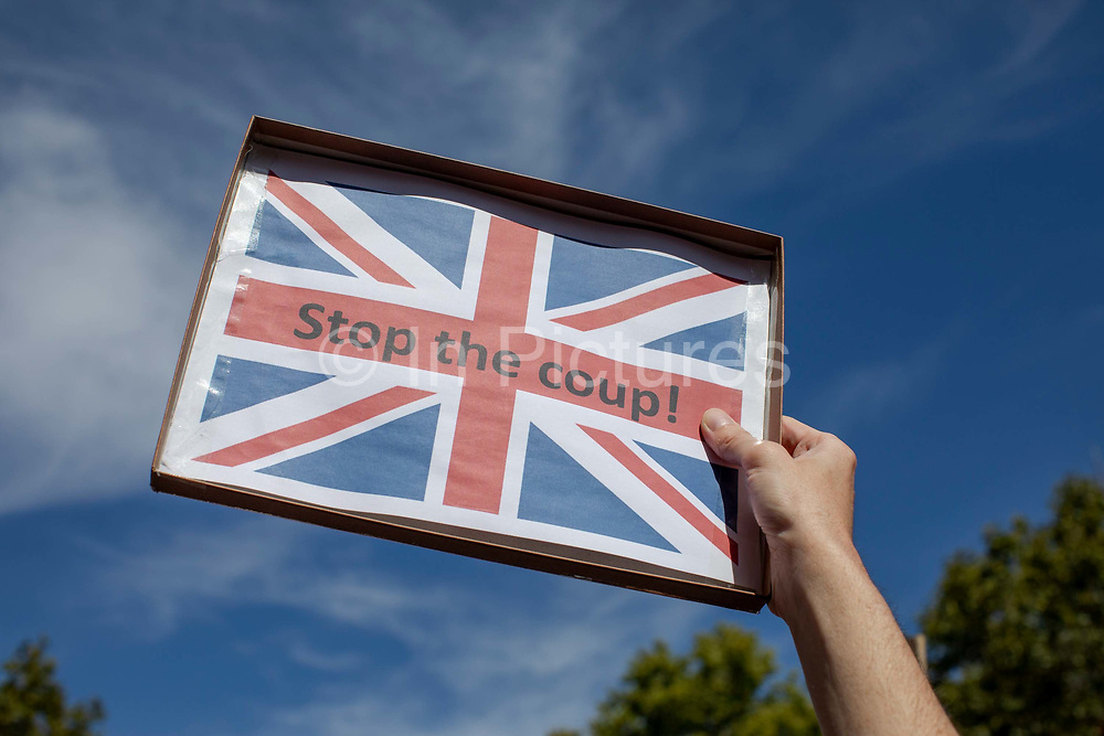 A Stop The Coup placard during protests against the proroguing of Parliament on 31st August 2019 in London in the United Kingdom. Left-wing group Momentum and the Peoples Assembly coordinated a series of Stop The Coup protests across the UK today, aimed at Boris Johnson and the UK government proroguing Parliament.