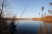 A fisherman in Uckermarkische Seen Natural park, part of the The Feldberg Lake District Nature Park containing large lakes, kettle bogs, and an abundance of plant and animcal species. Brandenburg, Germany. (Photo by Phil Clarke Hill/In Pictures via Getty Images).