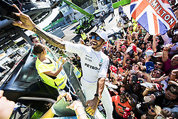 September 3, 2017 - Monza, Italy - LEWIS HAMILTON of Mercedes AMG Petronas F1 Team climbs a fence to take a selfie with fans after winning the FIA Formula One Grand Prix of Italy. (Credit Image: © Hoch Zwei via ZUMA Wire)