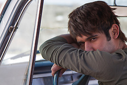 young man in sitting in a truck