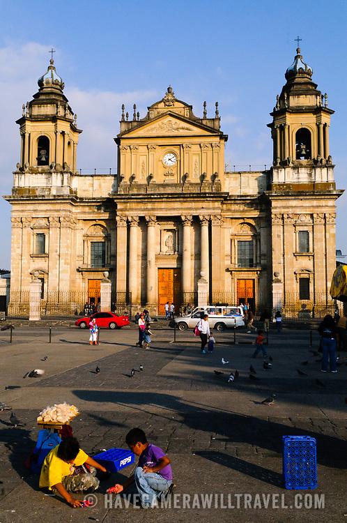 Children playing in Parque Central (officially the Plaza de la Constitucion) in the center of Guatemala City, Guatemala.
