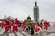 Participants with dogs take part in the Tokyo Great Santa Run in Komazawa-daigaku Olympic Park, Tokyo, Japan. Sunday December 22nd 2019, The great Santa Run was first run in Tokyo in 2018. This years run saw over 3,000 people in Santa costumes run and walk a 4.3 kilometre course to raise money for medical charities in japan and water projects for the Maasai in Kenya.