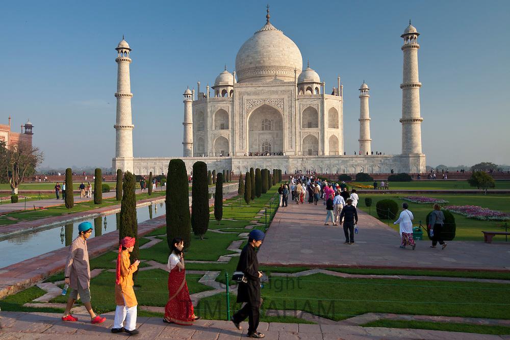 Asian tourists at The Taj Mahal mausoleum southern view Uttar Pradesh, India