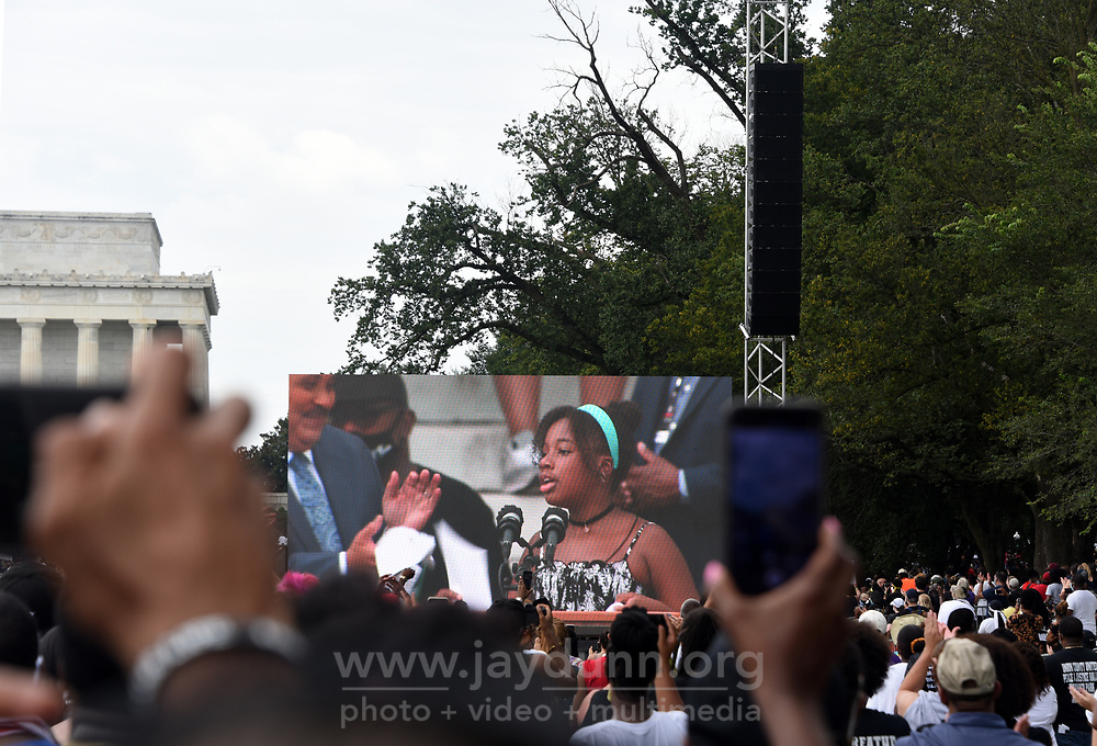 """Yolanda Renee King, 12, granddaughter of Martin Luther King, Jr, speaks before a huge crowd at the Lincoln Memorial. On Friday, August 28th, 2020, thousands of people from all over the country attended the Commitment March in Washington, D.C.to fight for criminal justice reform in solidarity with those who have lost loved ones at the hands of the police and to push for federal legislation against misconduct. The event, organized by the Reverend Al Sharpton and the National Action Network under the rallying call 'Get Your Knee Off Our Necks,' coincides with and honors the 57thanniversary of Martin Luther King, Jr.'s March on Washington, where he delivered his historic """"I Have A Dream"""" speech in 1963. Photograph by Jay Dunn."""