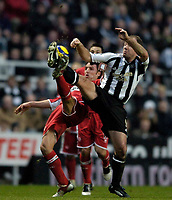 Photo: Jed Wee.<br />Newcastle United v Middlesbrough. The Barclays Premiership. 02/01/2006.<br />Newcastle's Alan Shearer (R) challenges Middlesbrough's Gareth Southgate for the ball.