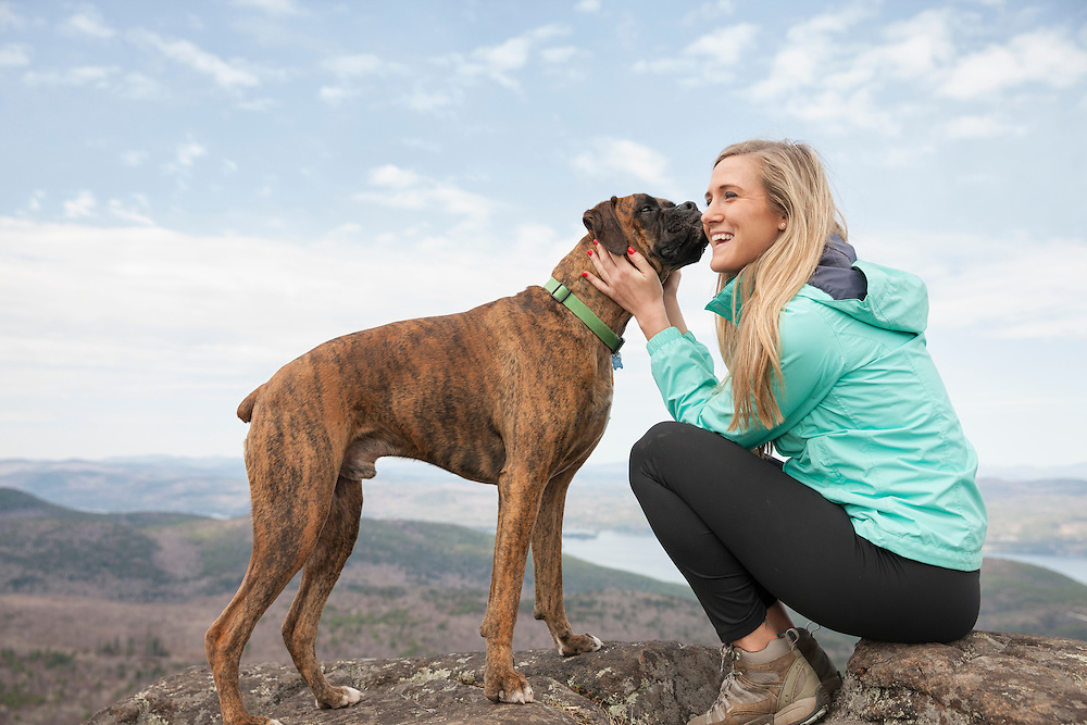 Lifestyle image of Boxer and owner on Sleeping Beauty Mountain in the Adirondack Park of New York