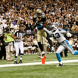 January 1, 2012; New Orleans, LA, USA; New Orleans Saints wide receiver Marques Colston (12) catches a touchdown over Carolina Panthers safety Sherrod Martin (23) during the second quarter of a game at the Mercedes-Benz Superdome. Mandatory Credit: Derick E. Hingle-US PRESSWIRE