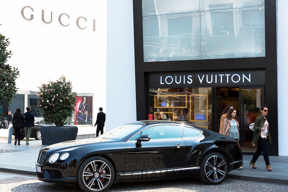 Bentley car Louis Vuitton designer Gucci fashion shop at Istinye Park shopping mall near Levent business center Istanbul, Turkey