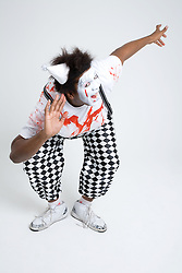 Man dressed in clown's fancy dress outfit fooling around,