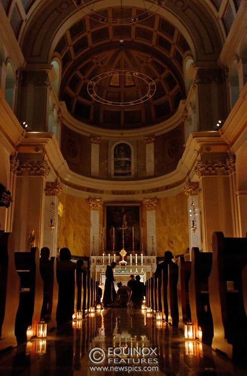London, United Kingdom - 10 August 2012.Invited in by the catholic Nightfever team on the streets of Soho, members of the public light candles at St Patrick's Catholic Church, Soho Square, Soho, London, England, UK..Contact: Equinox News Pictures Ltd. +448700780000 - Copyright: ©2012 Equinox Licensing Ltd. - www.newspics.com.Date Taken: 20120810 - Time Taken: 213125+0000
