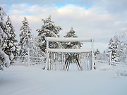 Reindeer fence at the edge of the forest on 19th February 2020 near Pallas-Yllastunturi National Park, Finnish Lapland. Established in 2005, Pallas-Yllastunturi is the third largest national park in Finland and is located in the Lapland region. The area has been inhabited since the Stone Age and is home to the Sami people, the National Park is an important pasture for reindeer.