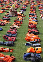 Rahela Sidiqi, a trustee of Women for Refugee Women, in Parliament Square in London which has been transformed into a 'graveyard of lifejackets' using 2,500 lifejackets worn by refugees crossing from Turkey to the Greek island of Chios, during an event organised in support of refugees to coincide with the UN Migration Summit.