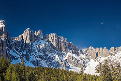 Moon over Mt. Latemar in Carreza in the Dolomite Mountains, South Tyrol, Italy