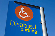 Disabled badge holders signs  in the car park of Tesco supermarket, Edmunton. London,