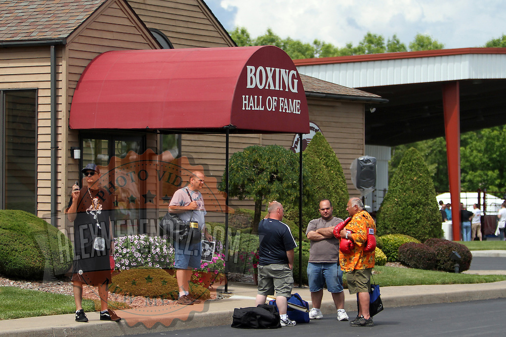 Fans gather for autographs during the 23rd Annual induction weekend opening ceremony at the International Boxing Hall of Fame on Thursday, June 7, 2012 in Canastota, NY. (AP Photo/Alex Menendez)