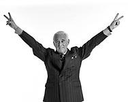 "Roger Stone mimicking Richard Nixon's famous good-bye ""peace"" salute"