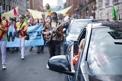 © Licensed to London News Pictures. 01/09/2020. Manchester, UK. Extinction Rebellion protestors march through the streets of Manchester. Photo credit: Kerry Elsworth/LNP
