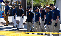 Oct 3,2017. Las Vegas, Nevada, U.S. - FBI  investigate at the concert scene after Sundays mass shooting Tuesday morning on the Las Vegas strip. A gunman opened fire on a music festival crowd from the 32nd floor of the Mandalay Bay Resort and Casino. At least 59 people died in the shooting and 515 people were injured Sunday night. The shooting has become the deadliest in modern U.S. history. (Credit Image: © Gene Blevins via ZUMA Wire)