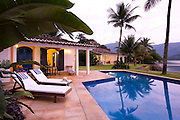 Private home in Parati Brazil. general views of the guest house and main house with the pool in the foreground.
