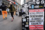 Debenhamsliquidation headline as the national lockdown ends and the new three tier system of local coronavirus restrictions begins, shoppers head out to Oxford Street to catch up on shopping as non-essential shops are allowed to reopen on 2nd December 2020 in London, United Kingdom. Many shoppers wear face masks outside on the street as a precaution as there are so many people around.