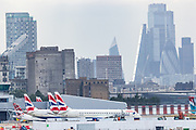 British Airways aircraft are parked up in London City Airport on Monday, July 27, 2020. After the British Government said that anybody travelling to Spain from Britain will now need to self-isolate for 14 days when they return, airlines connecting Britain to Spain have issued guidance to anybody with flights booked to Spain - and says that it will be continuing to operate, despite the new restrictions. (VXP Photo/ Vudi Xhymshiti)
