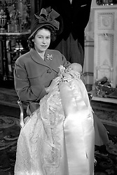 File photo dated 15/12/48 of Princess Elizabeth holding her infant son, Prince Charles, after his christening ceremony at Buckingham Palace.