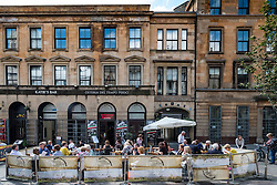Outdoor restaurant on street in Merchant City district of Glasgow, Scotland, United Kingdom