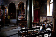 Person praying at Roman Catholic Cathedral of St Dionysius. Built in 1865, this stone basilica displays an interesting portico, resting upon a marble colonnade. The evocative interior reveals three separate naves with an abundance of marble columns and haunting frescoes. Athens is the capital and largest city of Greece. It dominates the Attica periphery and is one of the world's oldest cities, as its recorded history spans around 3,400 years. Classical Athens was a powerful city-state. A centre for the arts, learning and philosophy.