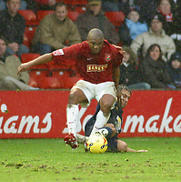 Photo: Dave Linney.<br />Walsall v Bristol Rovers. Coca Cola League 2. 30/12/2006. Walsall's Hecor Sam(Front) is brought down by  Andy Sandell.