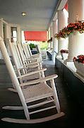 NJ, Spring Lake, Rocking chairs on porch of inn.