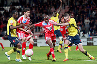 Ajaccio's Congolese defender Christian Kinkela (C) vies with Sochaux's defender Mathieu Philippe Peybernes (R) during a French L1 football match Ajaccio vs Sochaux in the Francois Coty stadium in Ajaccio on May 2, 2012. PHOTO PASCAL POCHARD-CASABIANCA / AFP / DPPI