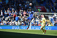 Bruno Ecuele-Manga of Cardiff city jumps over Millwall's Lee Gregory to head clear.   Skybet football league championship, Cardiff city v Millwall at the Cardiff city stadium in Cardiff, South Wales on Saturday 18th April 2015<br /> pic by Andrew Orchard, Andrew Orchard sports photography.