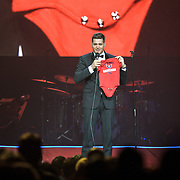 WASHINGTON, DC - September 22nd, 2013 - Performer Michael Bublé holds up a Washington Capitals baby tee, a gift from a fan during his concert at the Verizon Center in Washington, D.C. Bublé and his wife Luisana Lopilato had a son, Noah, in August. (Photo by Kyle Gustafson /  For The Washington Post)