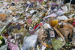 June 24, 2017 - London, United Kingdom - A photograph and tributes in the huge pile of flowers remembering those killed in the London Bridge attack at the south end of London Bridge. Most of the flowers have now faded. Peter Marshall ImagesLive (Credit Image: © Peter Marshall/ImagesLive via ZUMA Wire)
