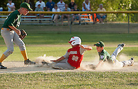 Laconia's Noah Cruz slides into second base ahead of the tag from Hooksett's Edward Upton during the Laconia Little League 11/12 All Star game at Colby Field Monday evening.  (Karen Bobotas/for the Laconia Daily Sun)