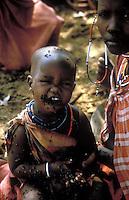fly infested masai boy in Kenya