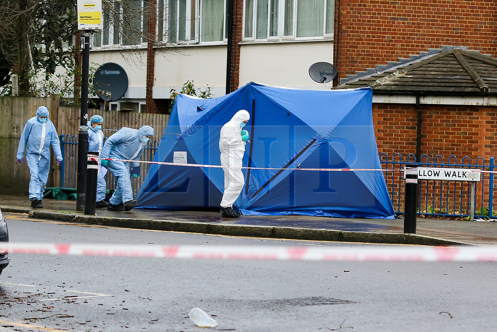 © Licensed to London News Pictures. 20/01/2021. London, UK. A forensic officer enters the police tent on West Green Road in Haringey, north London as police launch a murder investigation following the fatal stabbing of a teenage boy in Haringey. Police were called at 21:10hrs on Tuesday 19 January 2021 to the West Green Road junction with Willow Walk, following reports of a stabbing. Officers attended with the London Ambulance Service and found a male, aged 17, suffering from a stab injury. The victim was pronounced dead at 04:25hrs on Wednesday 20 January. . Photo credit: Dinendra Haria/LNP