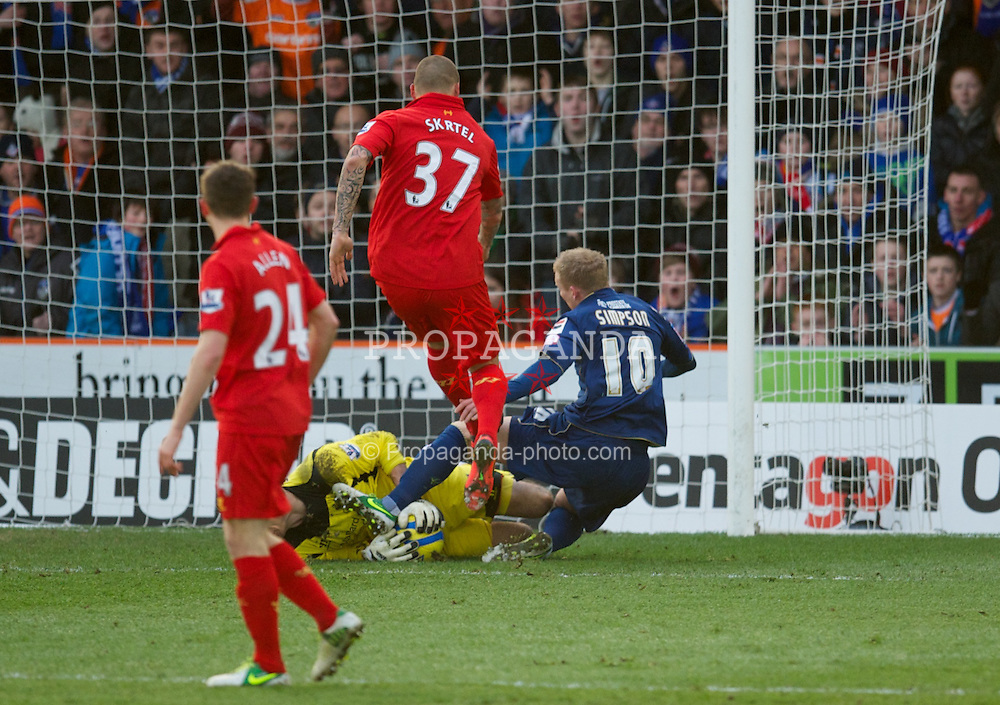 OLDHAM, ENGLAND - Sunday, January 27, 2013: Oldham Athletic's Robbie Simpson dives in on Liverpool's goalkeeper Brad Jones during the FA Cup 4th Round match at Boundary Park. (Pic by David Rawcliffe/Propaganda)