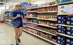 © Licensed to London News Pictures. 19/07/2021. London, UK. A shopper wearing a face covering in Sainsbury's superstore in north London. The Covid-19 measure of wearing face coverings is no longer mandatory as the legal requirement ends today, Freedom Day. The government recommends that people continue to wear a face covering in crowded and enclosed spaces. Shoppers shopping in Sainsbury's will need to carry on wearing face coverings.  Photo credit: Dinendra Haria/LNP