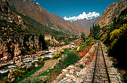 PERU, CUZCO - MACHU PICCHU TRAIN tracks passing through Urubamba Valley