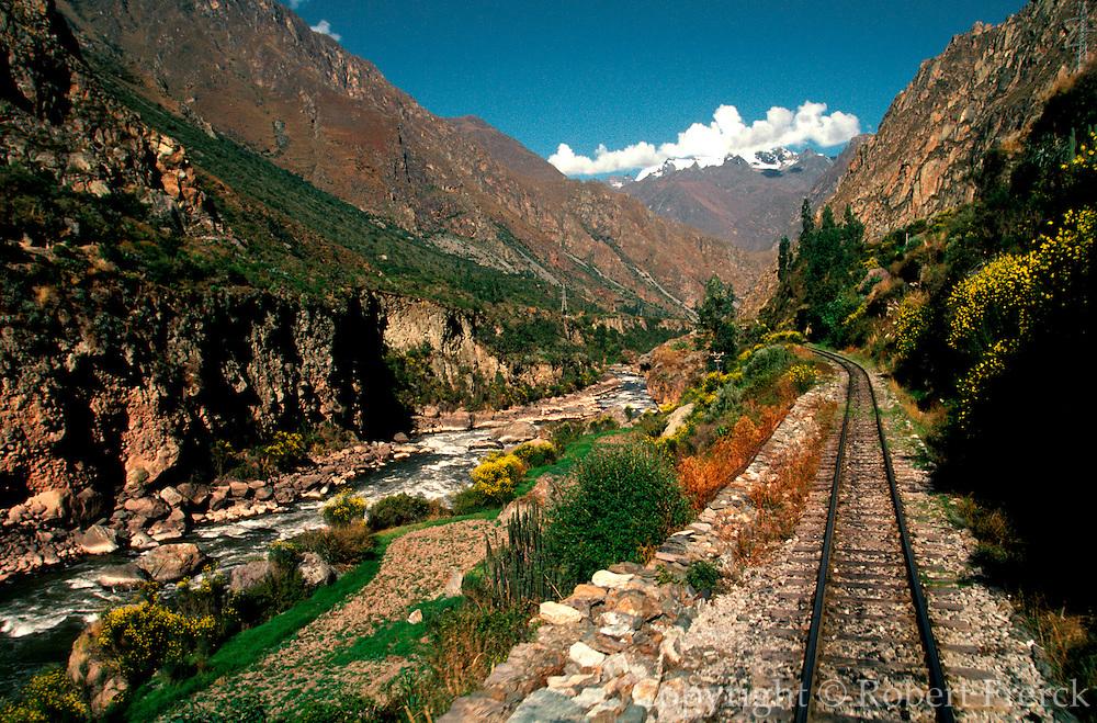PERU, CUZCO - MACHU PICCHU TRAIN tracks passing through Urubamba Valley