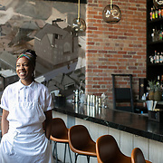 ASHEVILLE, NC - JUNE 29: Chef Ashleigh Shanti of Benne on Eagle, poses for a portrait inside her restaurant on Eagle Street in Asheville, NC on Saturday June 29, 2019. (Photo by Logan Cyrus / The New York Times)
