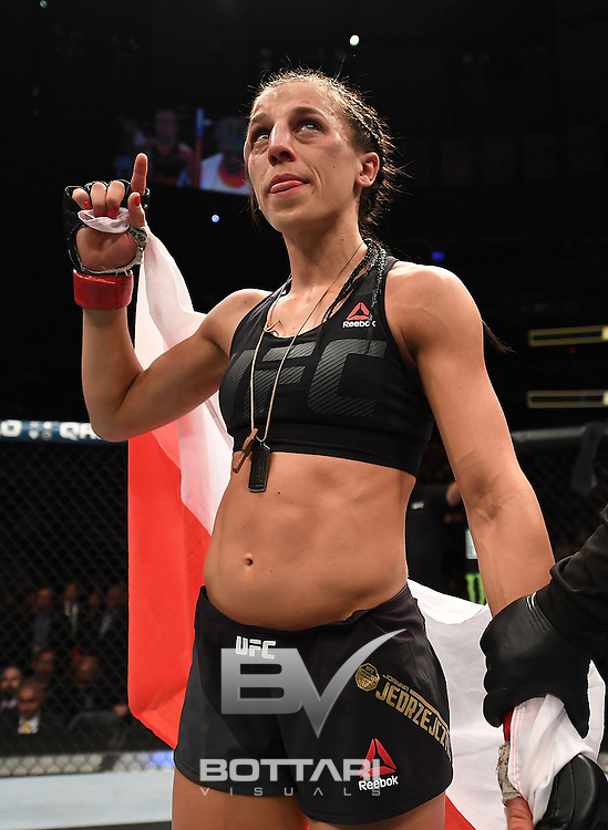 NEW YORK, NY - NOVEMBER 12:  Joanna Jedrzejczyk of PolanJoanna Jedrzejczyk of Poland is awarded the victory by unanimous decision against Karolina Kowalkiewicz of Poland in their women's strawweight championship bout during the UFC 205 event at Madison Square Garden on November 12, 2016 in New York City.  (Photo by Jeff Bottari/Zuffa LLC/Zuffa LLC via Getty Images)